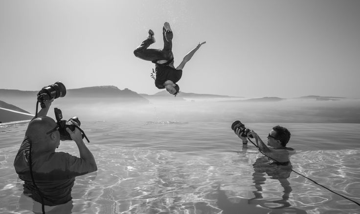 Jason Paul over the infinity pool in #Santorini