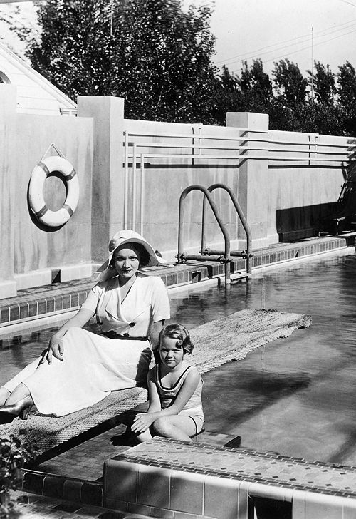 Marlene Dietrich and her daughter, Maria Riva, pose in front of their swimming pool at their home in Hollywood, C.1930's: