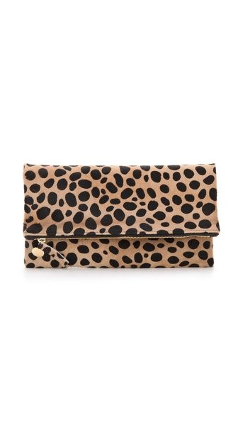 CLARE VIVIER Fold Over Haircalf Clutch    Another fun and bold piece to dress up or down any outfit