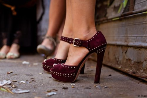 maroon heels with silver studs and ankle strap and open toe