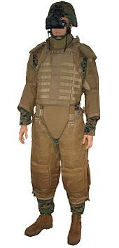 "Interceptor body armor - Mannequin of a U.S. Marine wearing a coyote-brown OTV and an additional corporal full protection called ""Quadgard IV"". This kind of protection was used by turret gunners during the Iraq War, to protect them against small arms fire and fragmentation."