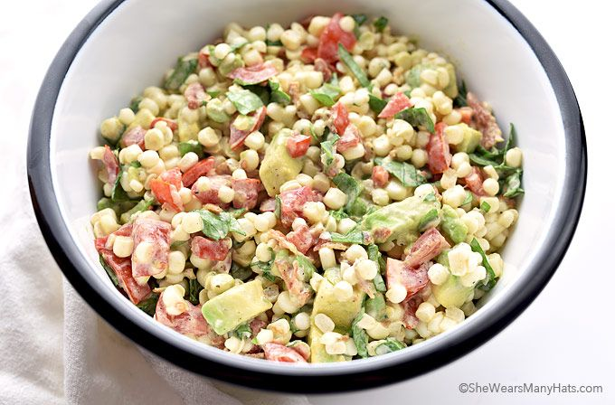 Fresh sweet corn mingles with avocado, bacon, tomato and spinach in this corn salad recipe that is the perfect side dish for summer.