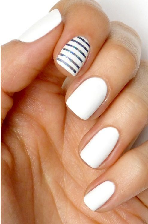 Recreate this look using Jamberry nail wraps Whiteout on all nails, and Metallic Silver Stripe for the accent nail!