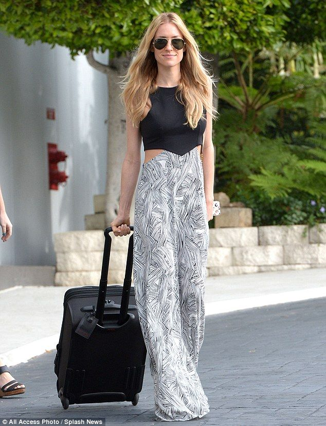 So elegant: Kristin wore a flowing maxi dress with cut out sides as she stepped out with luggage on Thursday