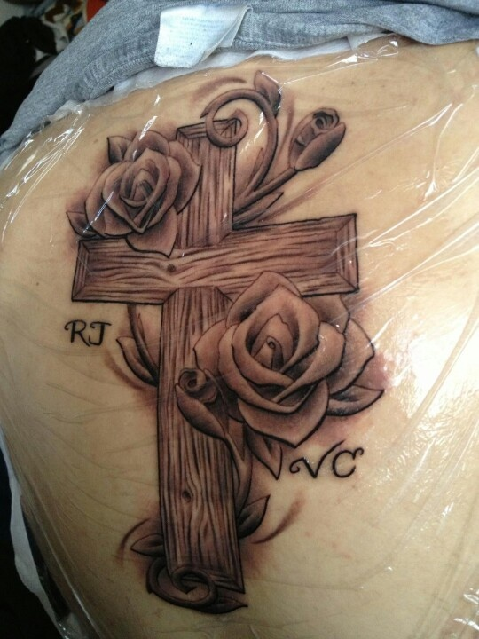 """On my ribcage with the words """"give me strength when I'm standing and faith when I fall"""" next it."""