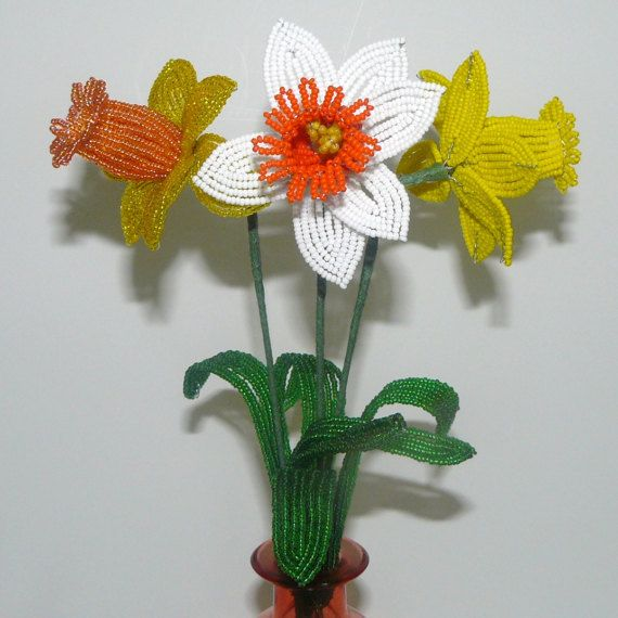 Here are a trio of French Beaded Daffodils, the flower of March. Did you know that Daffodils symbolize friendship? They are native to Mediterranean areas as well as North Africa and Asia. They grow from bulbs and flower in the Spring. French beaded flowers are created by stringing tiny seed beads on wire, forming each individual part of the flower, and then assembling it into a completed flower. They are works of art that will last forever with virtually no care.  There are three different…