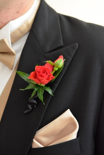 Red, spray rose boutonniere.