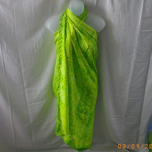 This sarong is in vibrant green and yellow - reminds me of limes and lemons! Made of rayon, this may be hand-washed and line-dried. Perfect for wrapping over a swimsuit at the beach, wearing as a skirt with a tank top or cami, tying on as a sca...