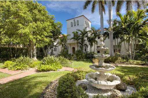 This Historic Mansion is going to be replaced by exact duplicate. This Miami home has white stucco walls, arched openings and expansive grounds with a concrete fountain.