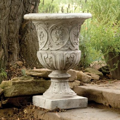 "Lippie Urn Planter made of durable, lightweight Fiber Stone — sand and stone cast on a fiberglass frame — so you can easily add classic Italian style to your garden, deck, patio or entryway.  Lippie Urn Planter Hand-finished detailing makes each urn a unique piece of art for your garden. Optional Pedestal elevates the planter to a magnificent 43""h. Urn measures 25""h x 18"" dia."