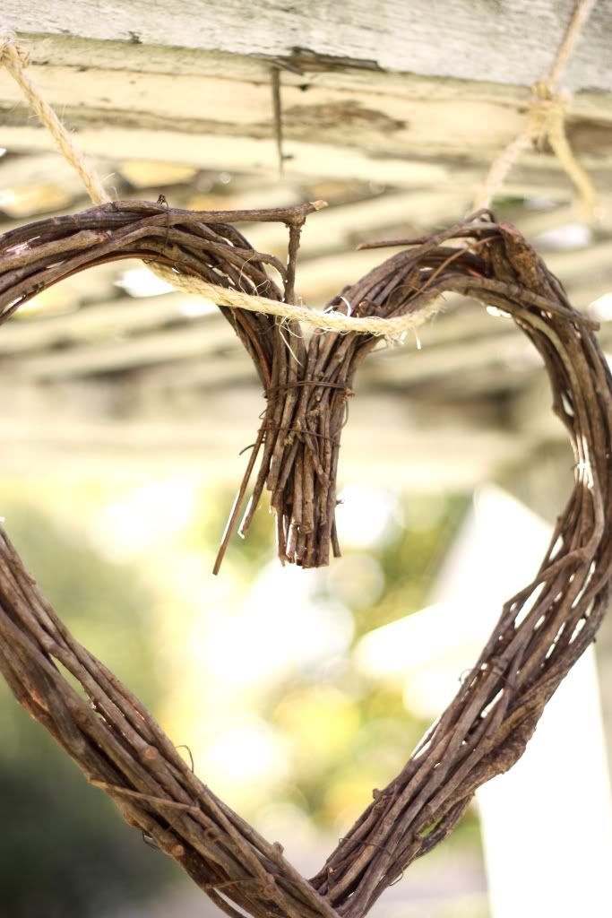 Grapevine heart makes for great decoration to a rustic engagement party or wedding. Momma maybe we can make these for the doors???!