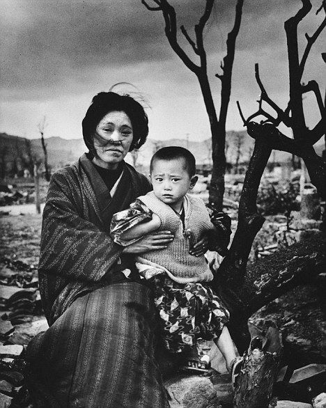 Survivors: A mother and child among the ruins of Hiroshima.