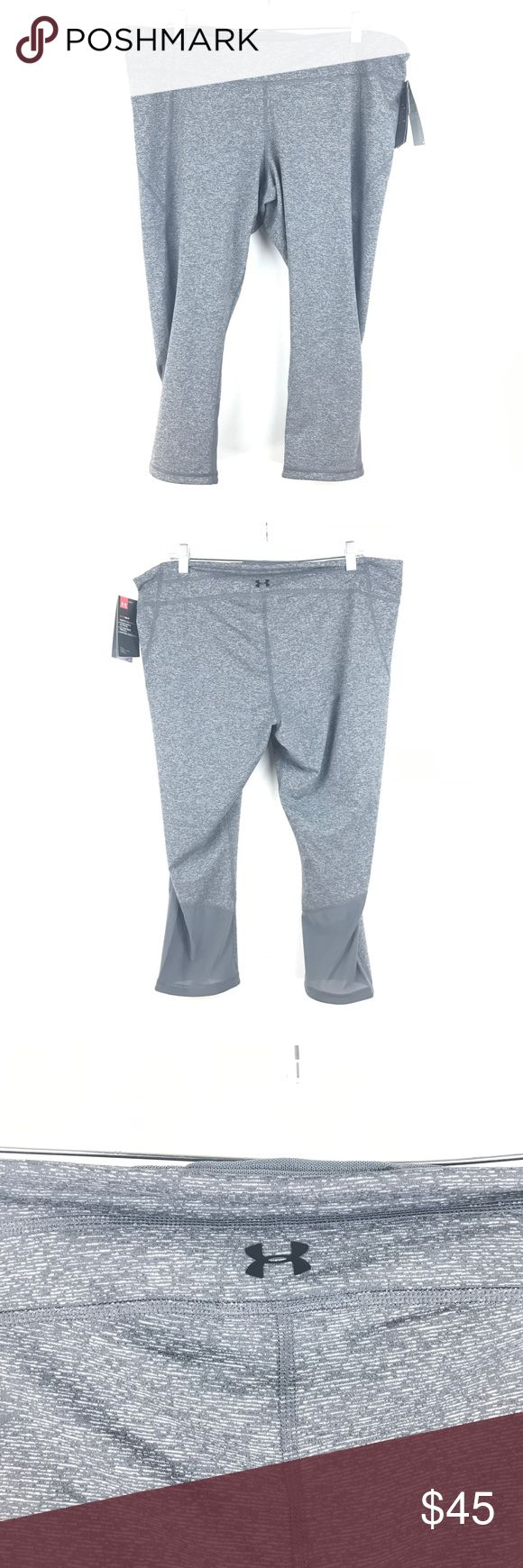 "Under Armour Gray Athletic Crop Pants Sz 2XL NEW Under Armour Women's Size XXL Heat gear Fitted Athletic Crop Pants Gray NEW 153  Measurements Inseam:  23""  Long  Brand New with original tags attached Retail Price $65 Under Armour Pants Capris"
