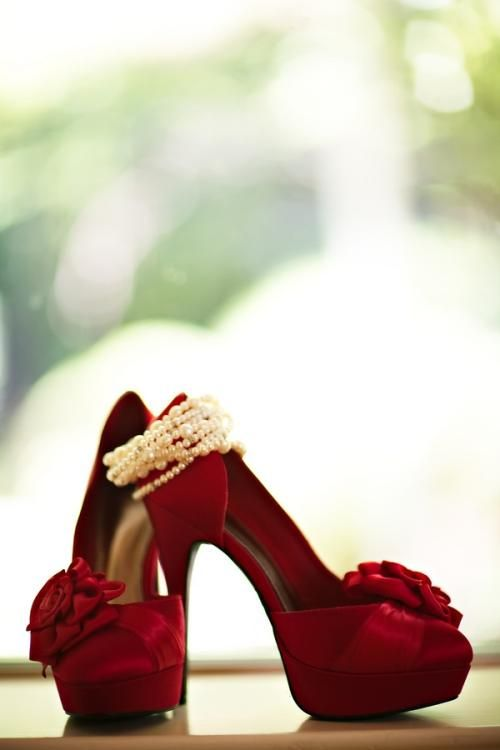 Red pumps and pearls