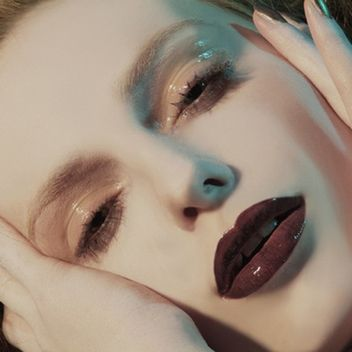 Peachy-beige glossy lids with a dark lip. Loving the pale skin and brows, too.