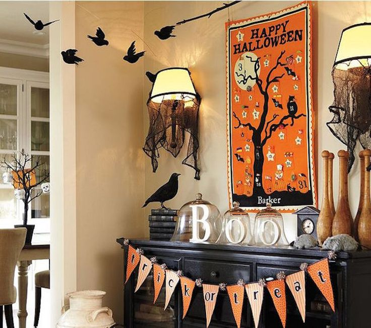 Decorations Black Fireplace Mantel That Extends Above It Also Orange Halloween Poster Plus Wall Shade Lamps Besides Black False Birds And Glass Bell Jars With Printable Halloween Alphabet Bunting Flags Also Dried Branch Plus Dark Vintage Cabinet