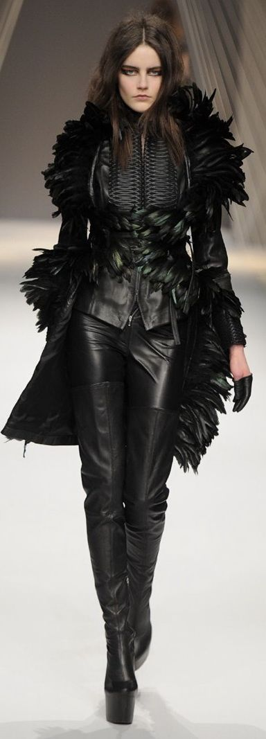 If I was a super bad ass chick like in Underworld or resident evil.. this would be my black outfit to kick ass in. feathers and all.