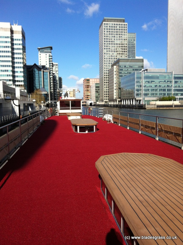 Blades installed the red artificial grass backdrop on the Royal Barge for the Queen's Jubilee. Here is it after the installation but before the rest of the transformation was complete!