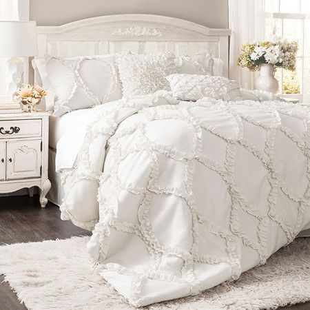 Bring a feminine touch to your master suite or guest room with this lovely comforter set, showcasing a ruffled trellis motif and soft white hue.