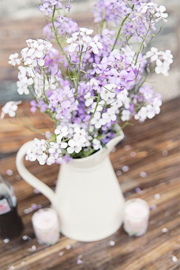 simple white and lilac flowers in a jug - Read more on One Fab Day: http://onefabday.com/katie-kavanagh-ballybeg-house/