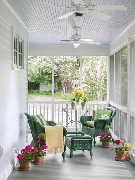 A side portion of this rebuilt front porch is screened to allow the homeowners to enjoy insect-free summer evenings alfresco. The porch ceiling is painted a traditional blue.