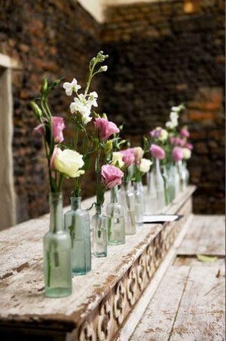Vintage Romance Wedding at Nooitgedacht Estate {Real Wedding} | Confetti Daydreams - Glass bottle vases with flowers and the order of the day displayed on a pallet ♥ #White #Green #Wedding ♥ ♥ ♥ LIKE US ON FB: www.facebook.com/confettidaydreams ♥ ♥ ♥