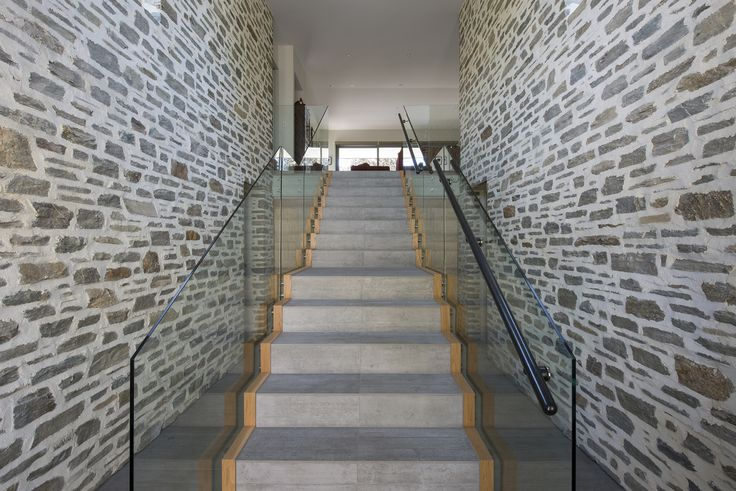 A modern stair with brick walls on each side - designed by Bruce Banbury from Banbury Architects #ADNZ #architecture #stairs