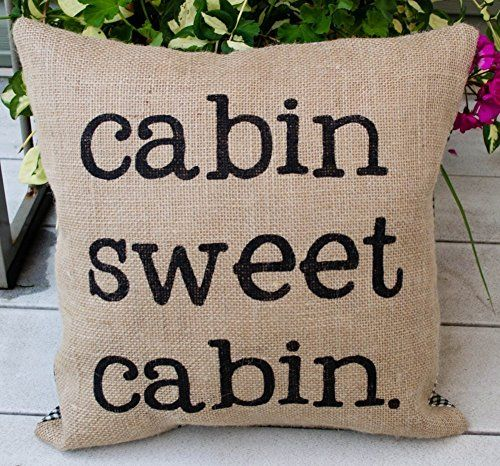 Get this Burlap Cabin Sweet Cabin Throw Pillow, which is burlap brown and says the words 'Cabin sweet cabin' on the pillow.  It's perfect rustic beach decor.