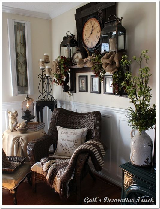 beautiful faux mantle display that could be replicated with oversize lanterns large wall clock burlap and greenery
