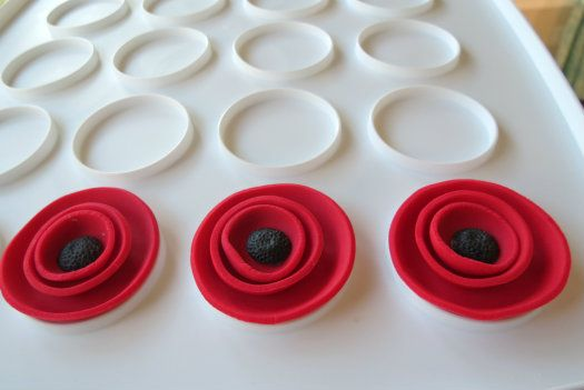 Tutorial on making poppy cupcake toppers that make a big impression due to their size and vibrant color. Could be made for any type of party.
