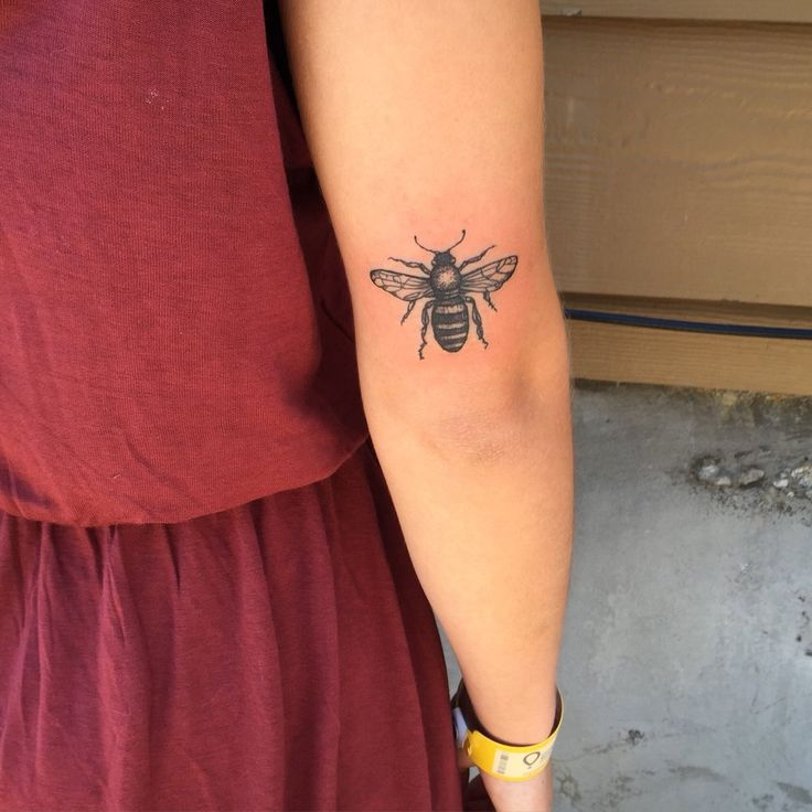 Forbidden School of Body Art & Tattoo Studio - Portland, OR, United States. Simple nature tattoo of a blackwork bee by Violet @violet_tattoo_pdx
