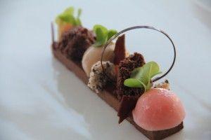 Fine dining - chocolate pie with aerated ganache, choc sorbet, lemon, peach, chocolate meringue