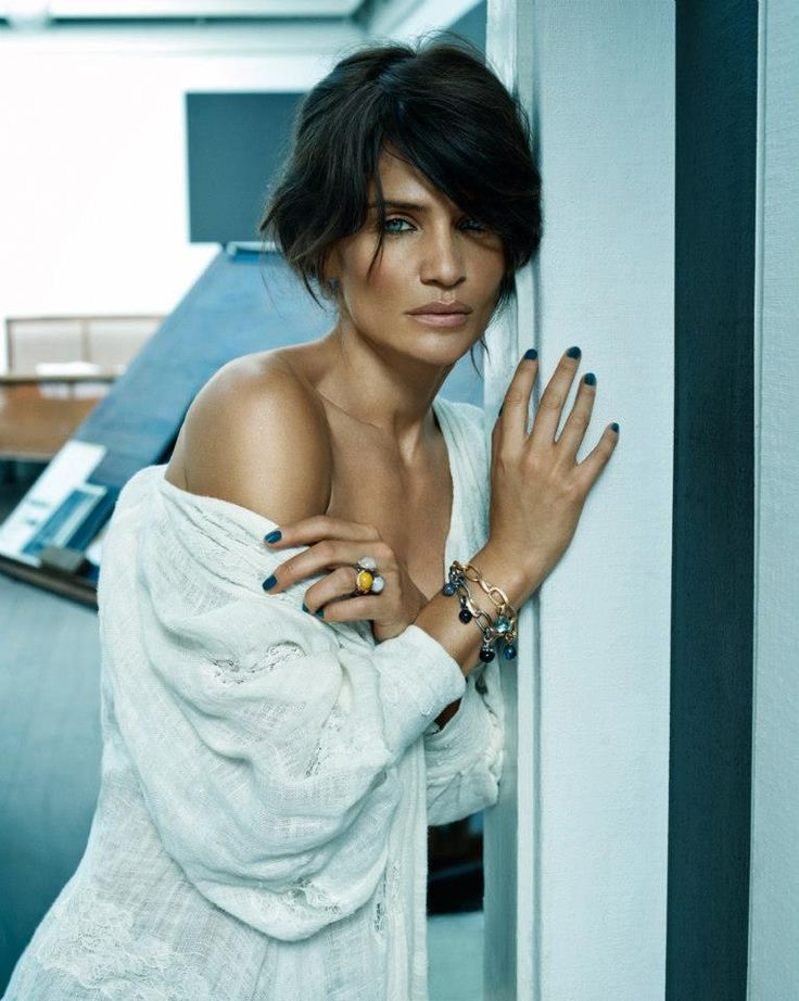 Helena Christensen wearing Ole Lynggaard love bracelets, sweet drops and stacked Lotus Rings available from http://www.masterjewellers.com.au/