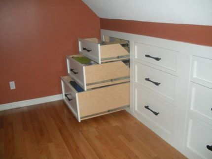 For our upstairs area with angled ceilings! Maybe convert the entire wall to dressers