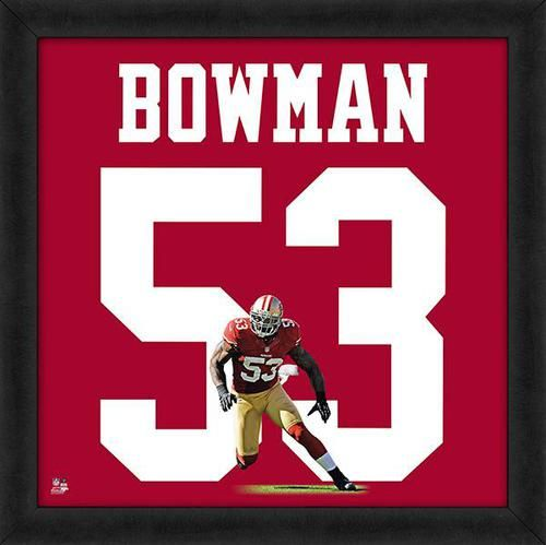 Featured is a NaVorro Bowman framed NaVorro Bowman jersey photo. This photo has been professionally framed and is approximately 20x20. **Note: This photo is not signed.**