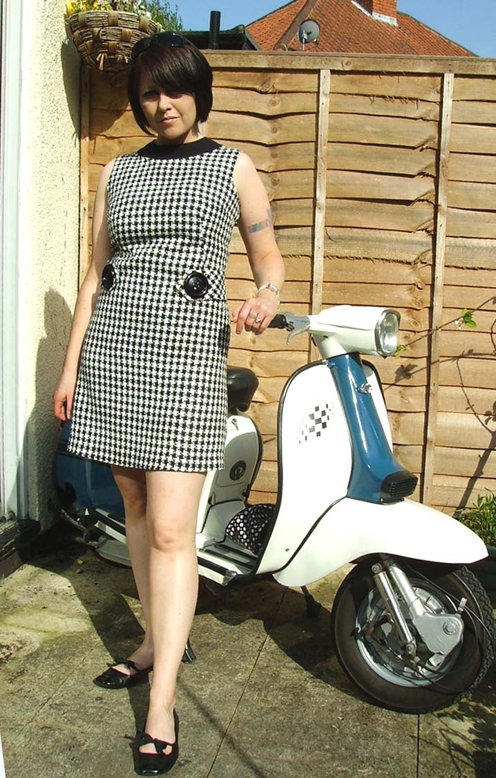 Love this dress and that scooter is to die for.