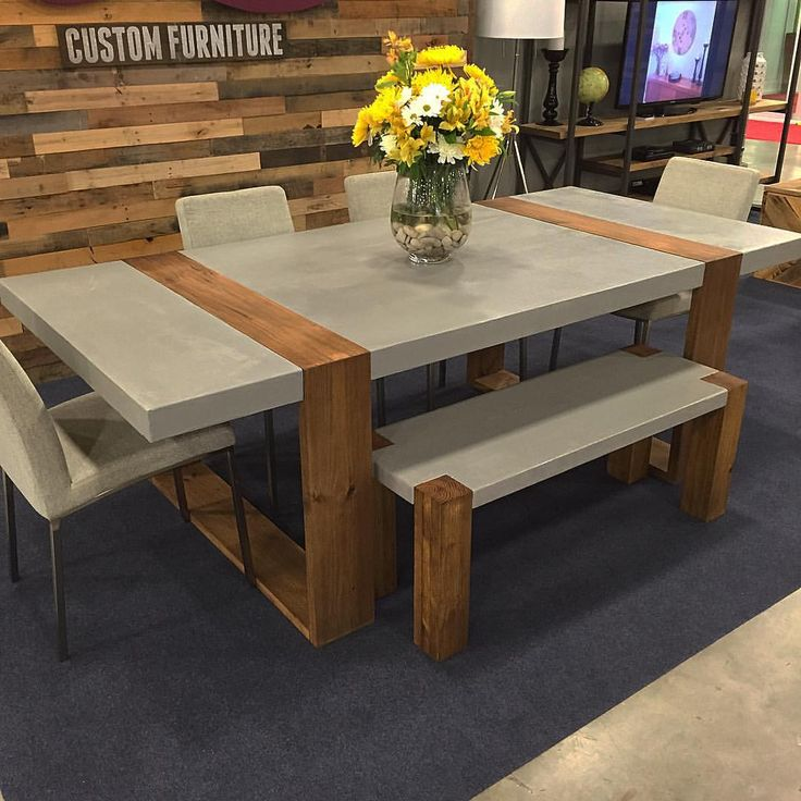 Dining table and bench made with concrete and wood.
