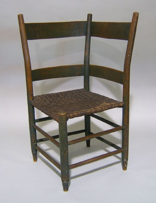 Southern hickory roundabout chair, early 19th c., with a leather rush seat, retaining an early green surface.