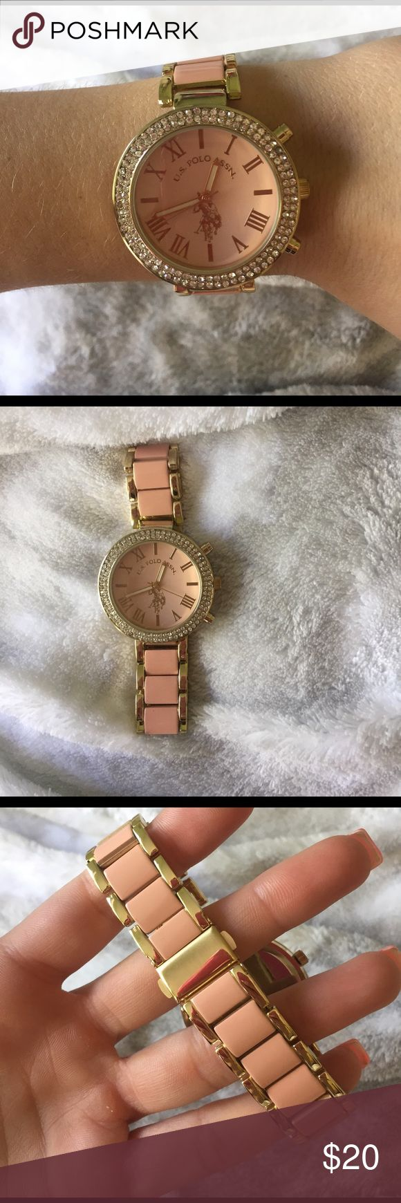 U.S. Polo Watch U.S. Polo watch. Super cute! Perfect for any occasion. Gold and salmon pink colored. Rhinestones around the face of the Watch and Roman numerals as the numbers. Never been worn, and no links were taken out. U.S. Polo Assn. Accessories Watches