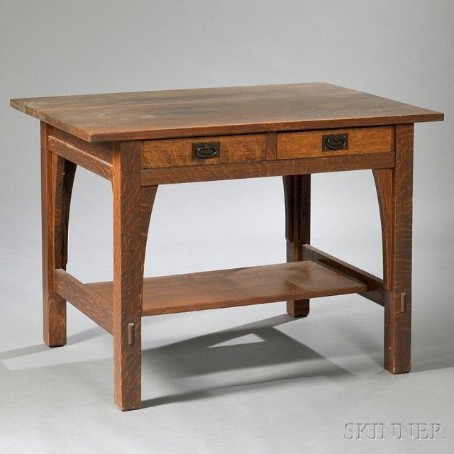 Gustav Stickley Arts & Crafts Library Table  Oak and copper  New York, c. 1912  Rectangular top over two drawers, long corbel supports, lower median shelf, wear some marks and nicks, unmarked, ht. 30, wd. 42, dp. 29 1/4 in.