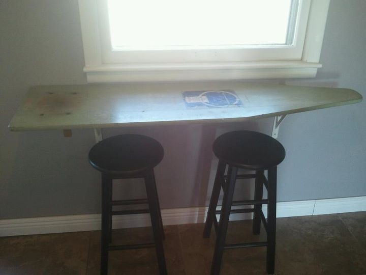 Breakfast bar made with an old wooden ironing board.