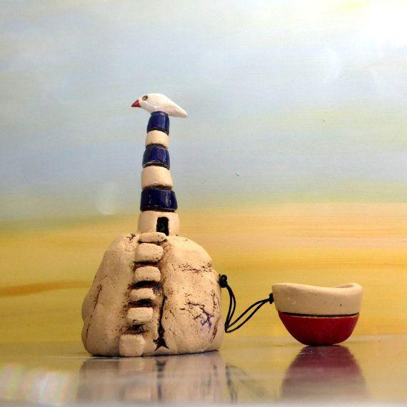 Miniature lighthouse ceramic sculpture  with a ceramic by ednapio, $38.00