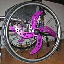 Hot pink spinners for manual wheelchair. >>> See it. Believe it. Do it. Watch thousands of SCI videos at SPINALpedia.com