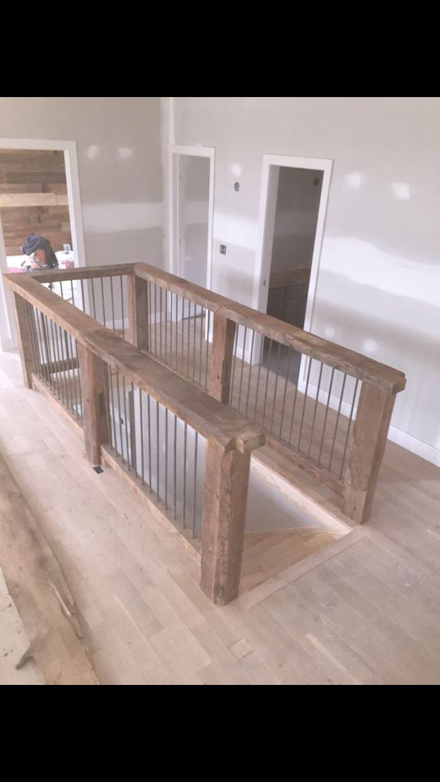Reclaimed wood banisters with reclaimed steel rerod balusters