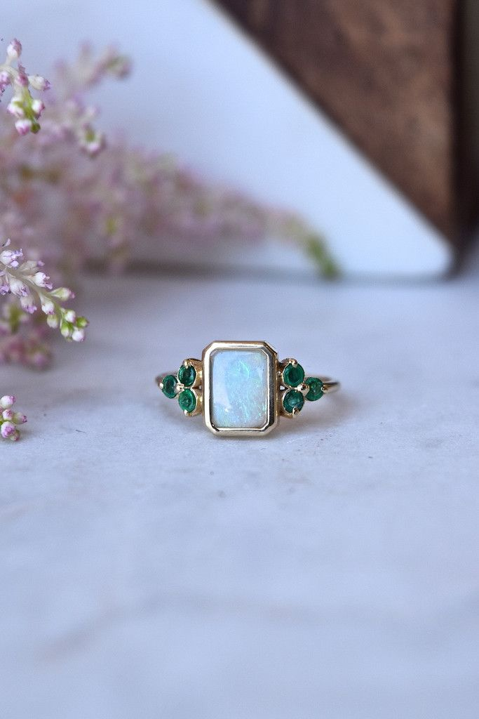 STONE�| Welo Ethiopian Opal, 6 round faceted Emeralds set in a vintage style ring�FINISH | 14kt yellow gold�SIZE�|�7, one of a kind