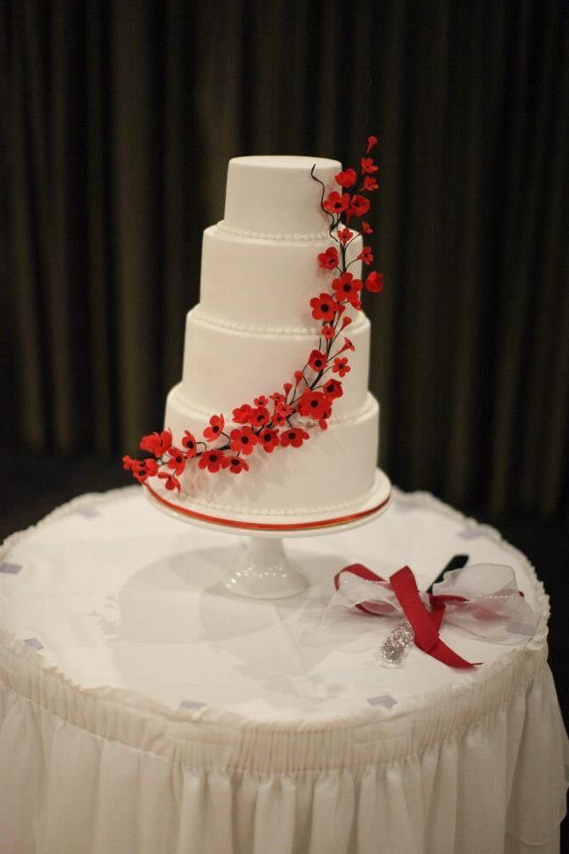 Four tiered red cherry blossom wedding cake