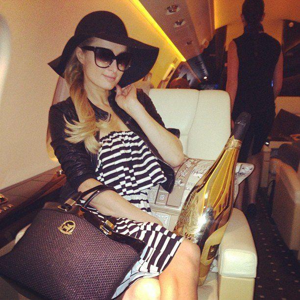 Paris Hilton with a huge bottle of #ArmanddeBrignac