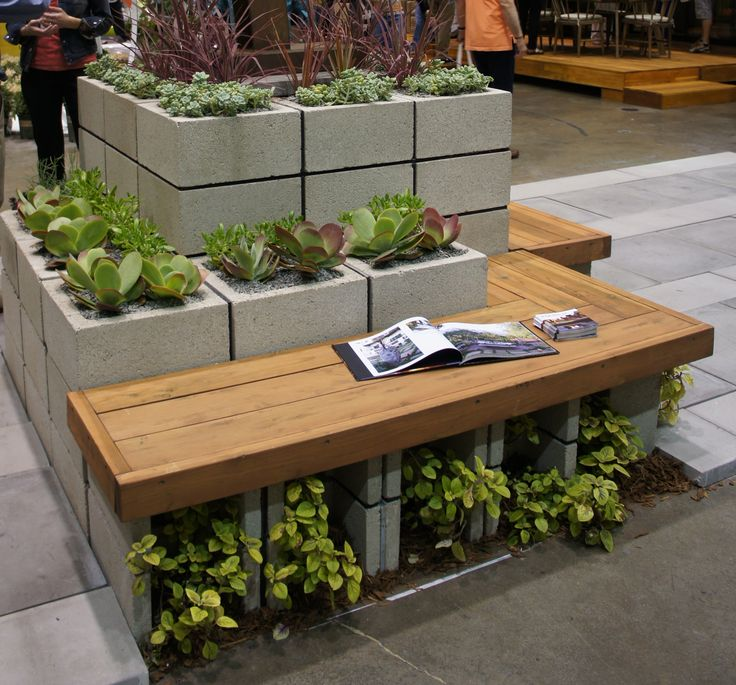 cinder block garden wall with a bench to sit