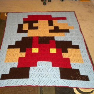 8-Bit Mario Blanket - Made from Granny Squares. I love the idea of doing other 8-bit characters. Although I could see that getting out of hand... Maybe just an 8bit link... or yoshi .. or bowser >_