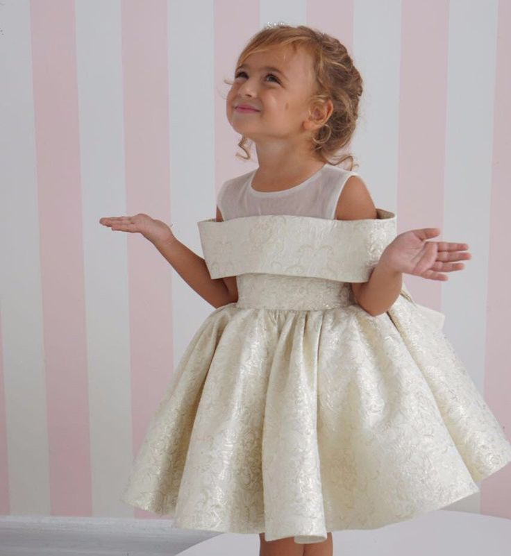 The Clarissa Dress is flirty and sophisticated. She'll feel like a big girl in this gorgeous jacquard fabric dress with peekaboo shoulders. The thick jacquard f